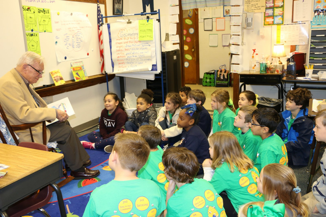 Rotarian reads to students