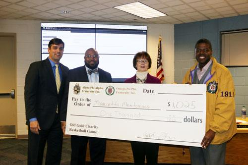 Marietta Mentoring for Leadership Check Presentation